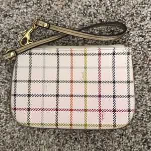 White and multicolored patterned coach wristlet